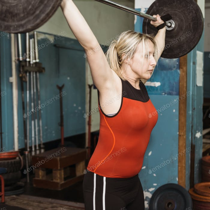 Female on weightlifting training