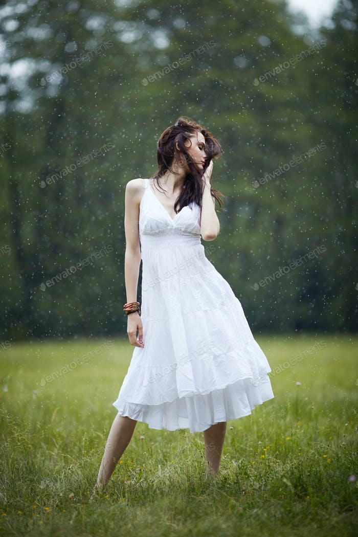beautiful girl under rain