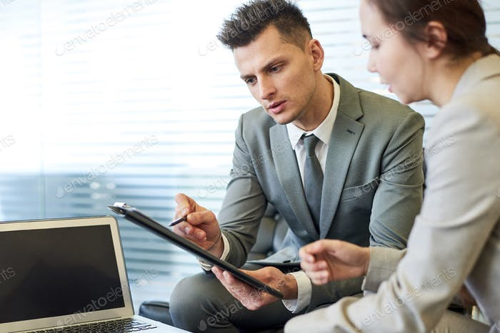 Successful Young Businessman in Meeting