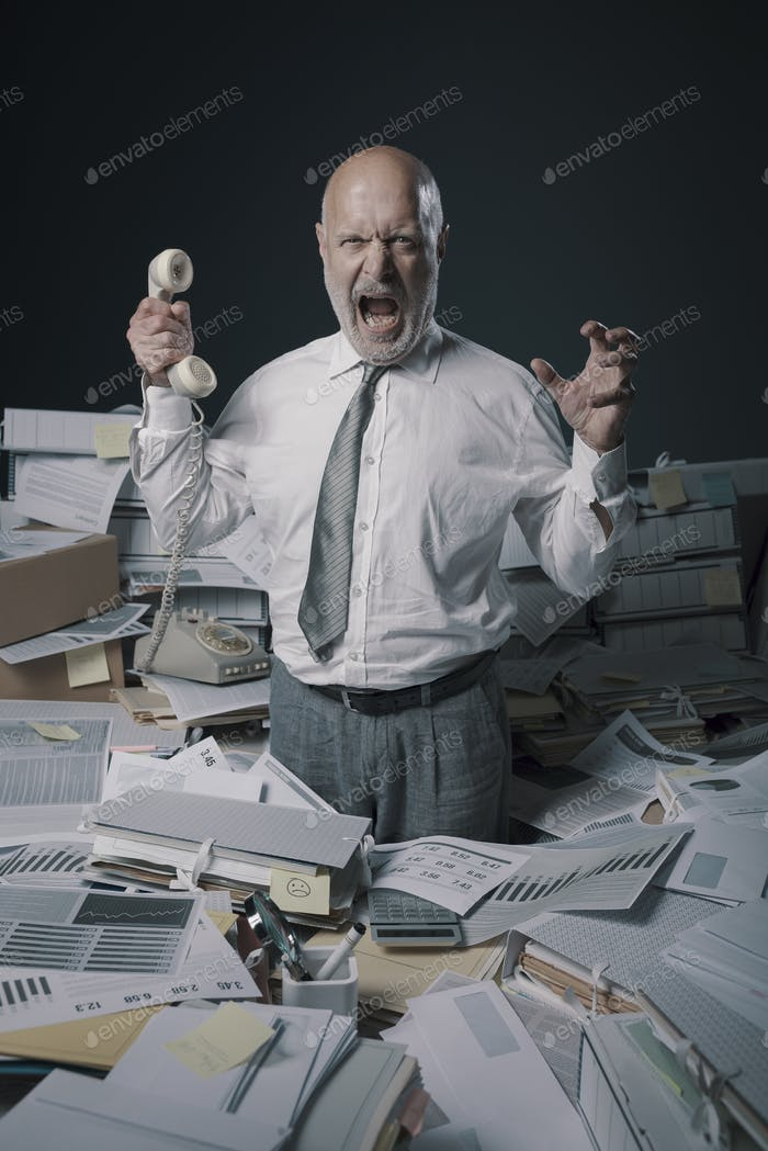 Stressed business executive overwhelmed by work
