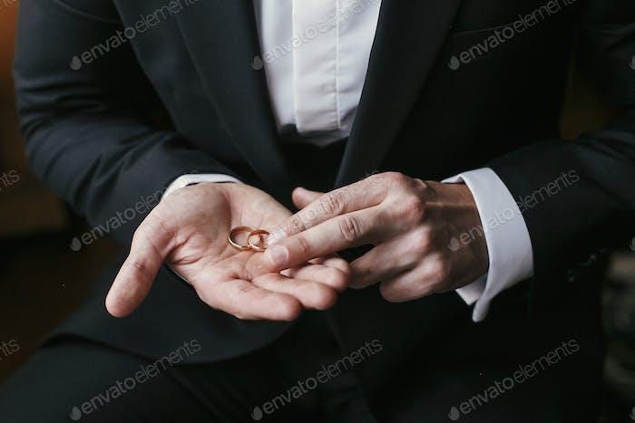 Wedding rings on palm hand