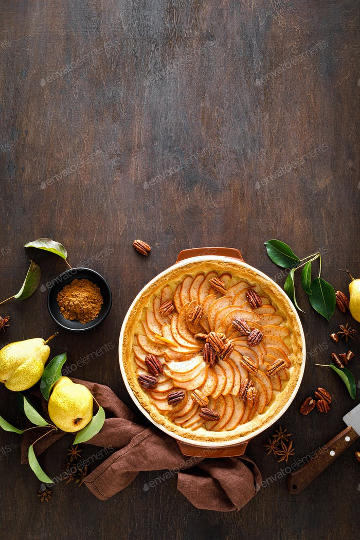 Pear tart, pie or cake with fresh pears, cinnamon and pecan nuts