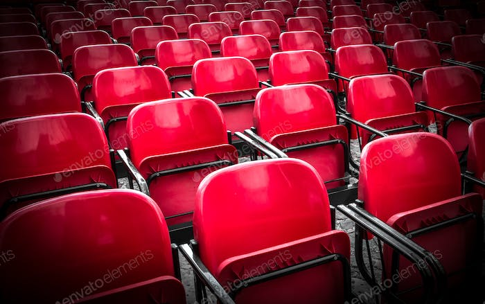 Red seats into the outdoor theatre