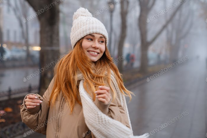 Attractive smiling young girl wearing winter clothes