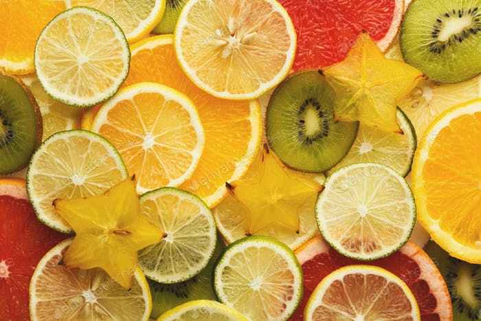 Exotic fruits slices background