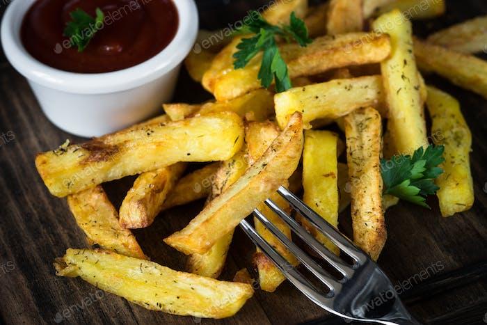 Fried potato with ketchup sauce