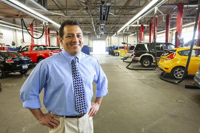 Portrait of Hispanic auto repair shop owner