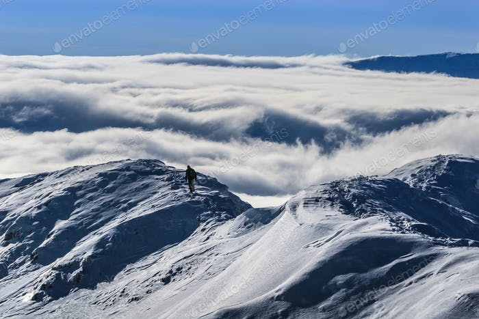 climbing the mountain in winter