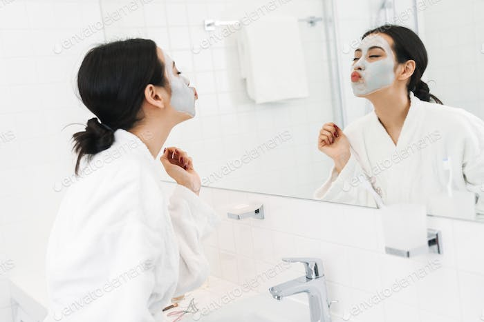 Optimistic young woman take care of skin
