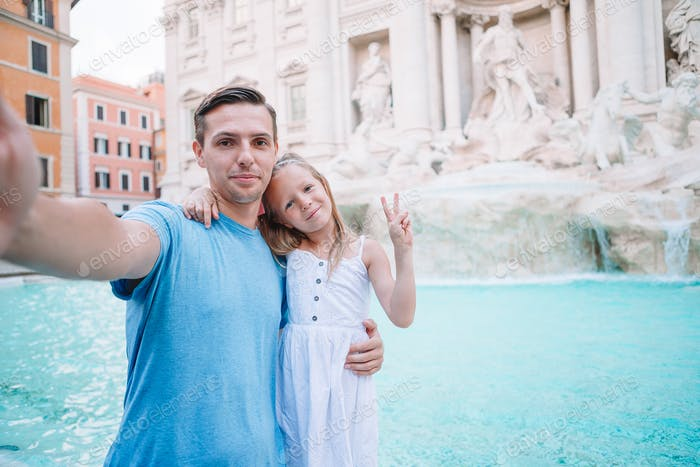 Happy kid and dad enjoy their european vacation in Italy