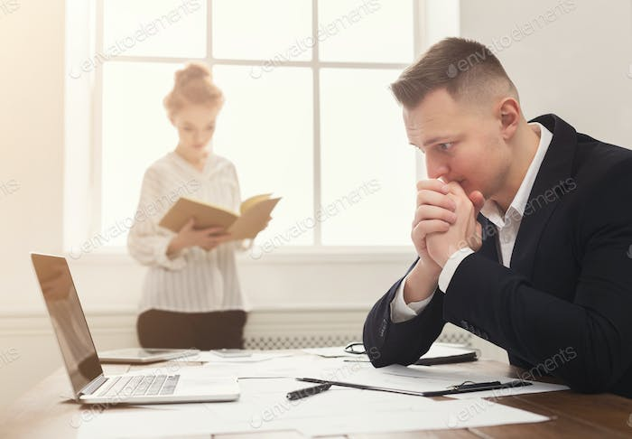 Thumbnail for Male and female managers working on financial papers at modern office interior