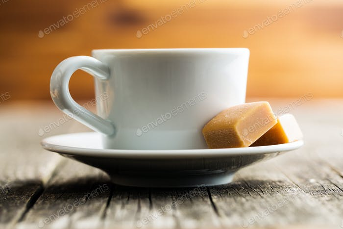 Coffee cup and caramel candies.