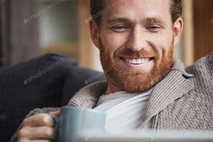 Handsome Man Enjoying TV Series at Home