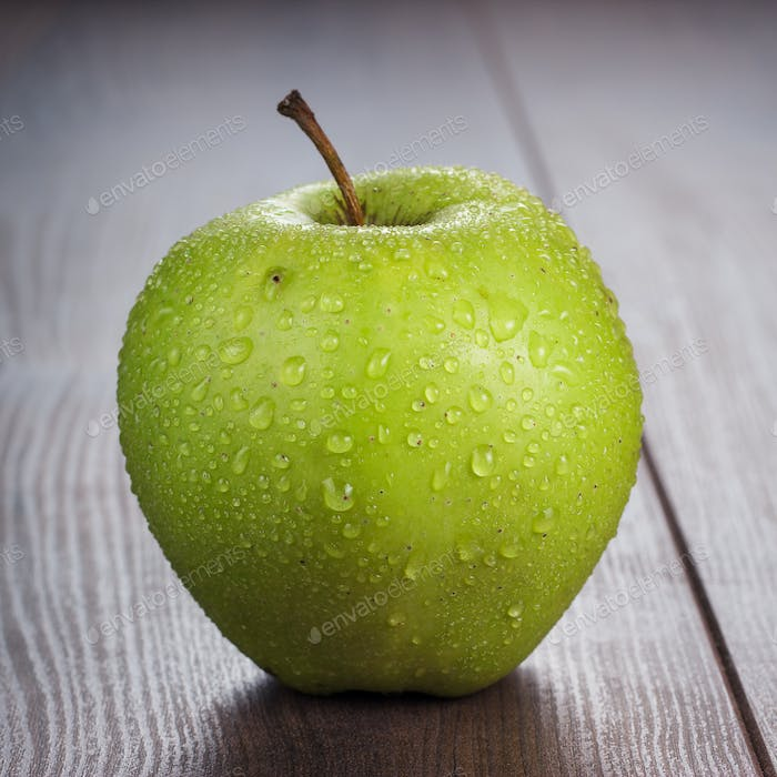 Fresh Green Apple On The Table
