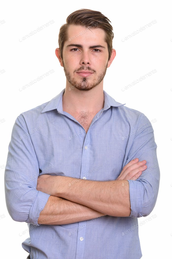 Portrait of young handsome bearded businessman with arms crossed