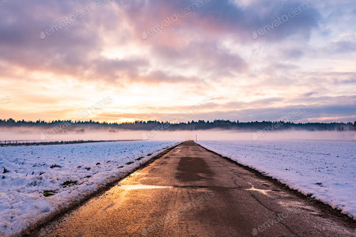 Winter landscape with road, white fields
