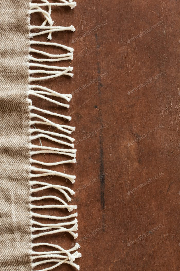 warm wool throw on wooden background