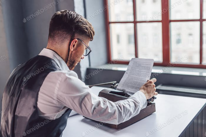 Young professional reading the script