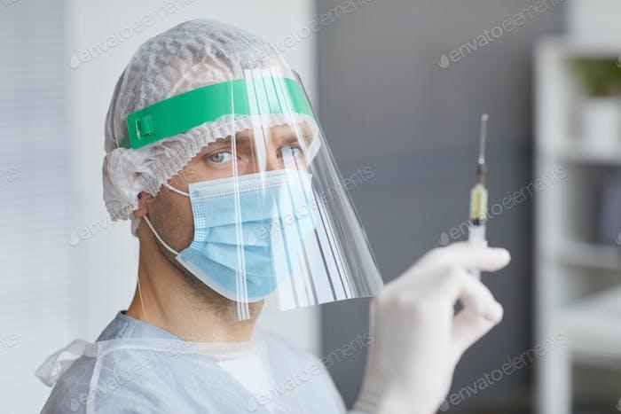 Male Doctor Holding Syringe