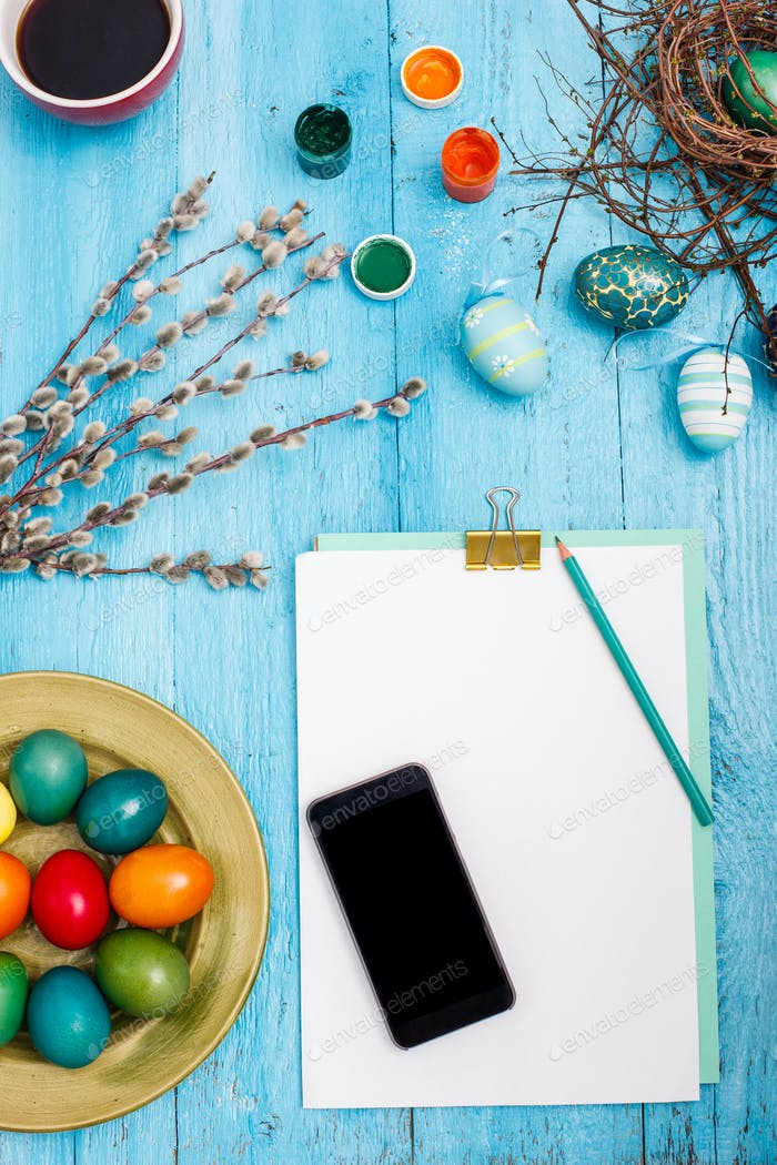 The top view of easter on wooden table office workplace