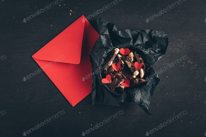 Chocolate and red envelope present for St Valentines Day
