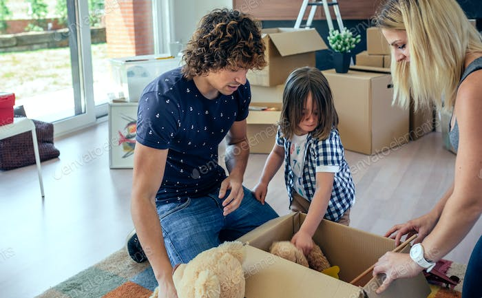 Family preparing moving toy box