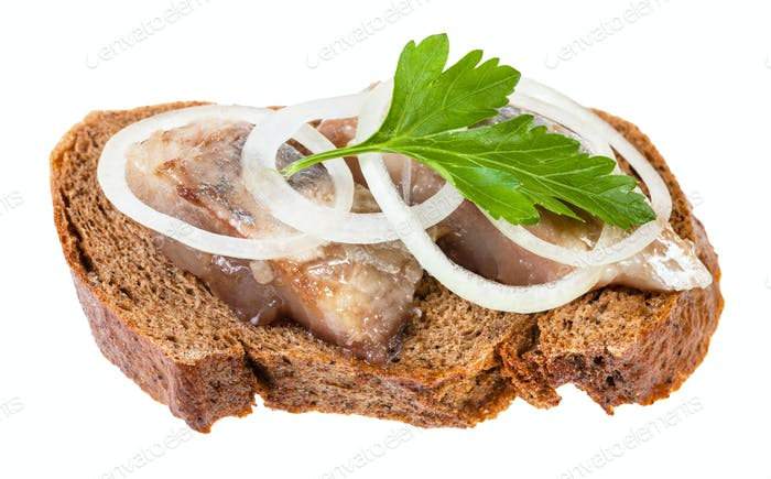 open sandwich with herring, onion, parsley