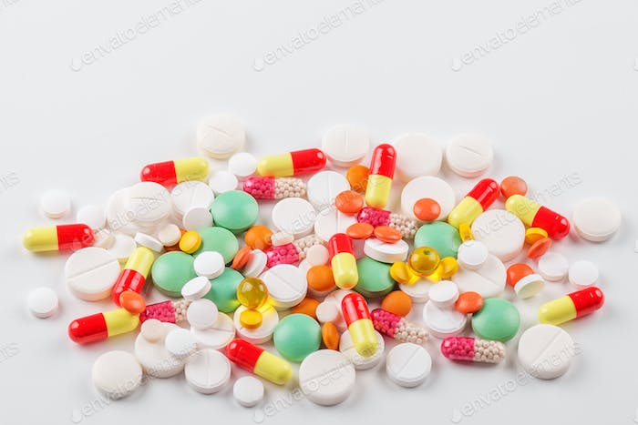 A lot of pills and vitamins. The concept of medicine, disease, health.