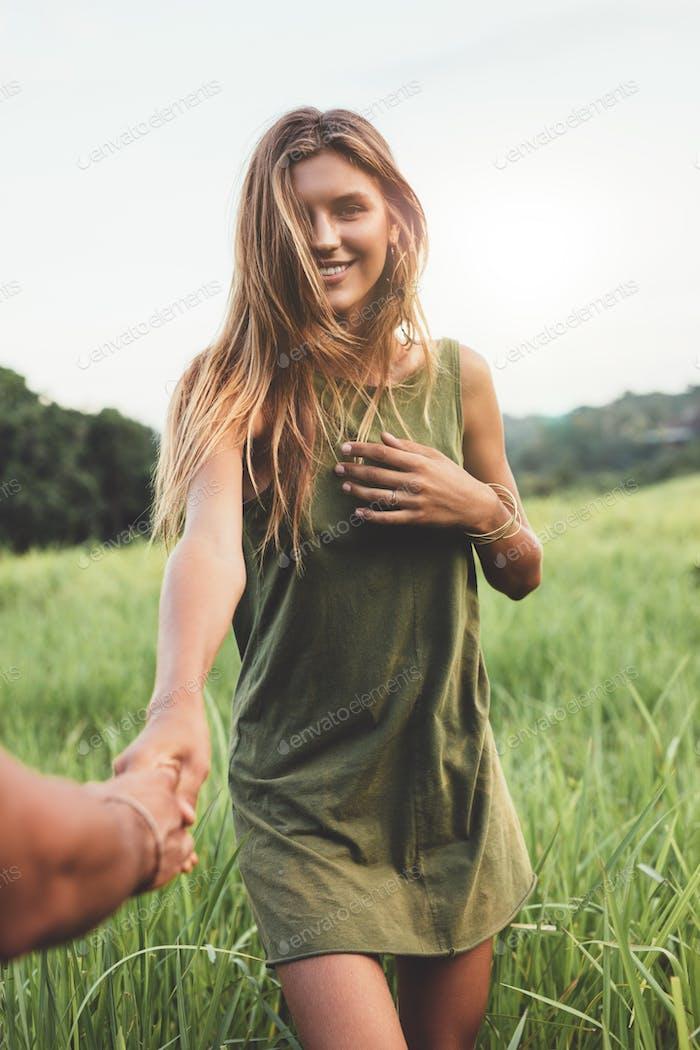 Beautiful woman in field with her boyfriend