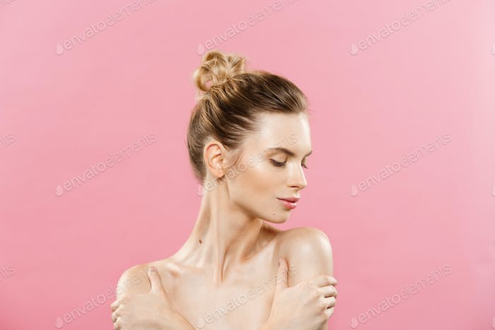 Beauty Concept - Beautiful Caucasian woman with clean skin, natural make-up isolated on bright pink
