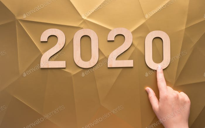 Technological 2020 new year background of gold with lines