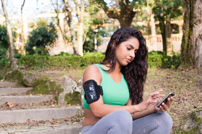 Fitness woman using phone