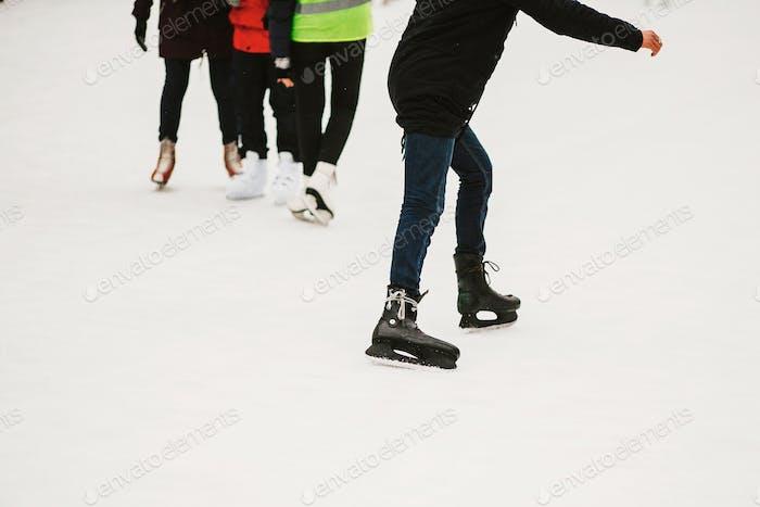 Skaters skating on iceskating ring in european city center in winter holidays