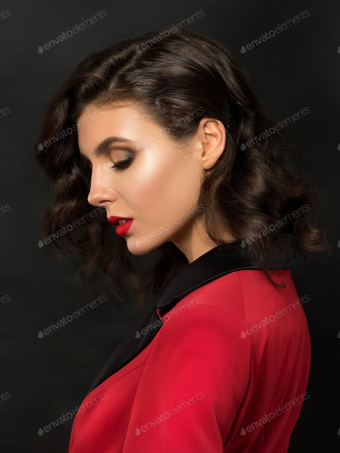 Portrait of young woman in red suit