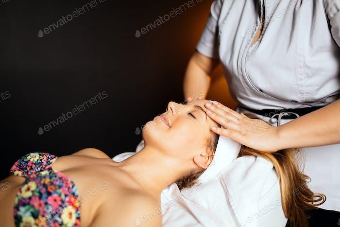 Pampering massaging of face