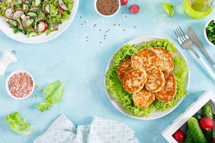 Fresh vegetable salad with radish and fried chicken meat cutlets