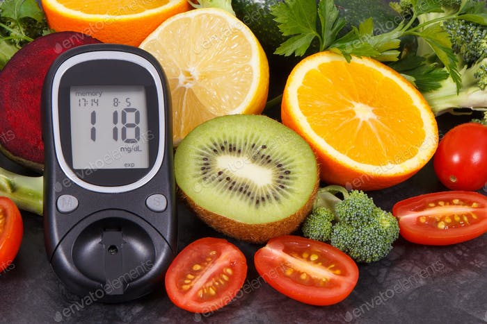 Glucometer with result of sugar level and fruits with vegetables, diabetes and nutritious dessert