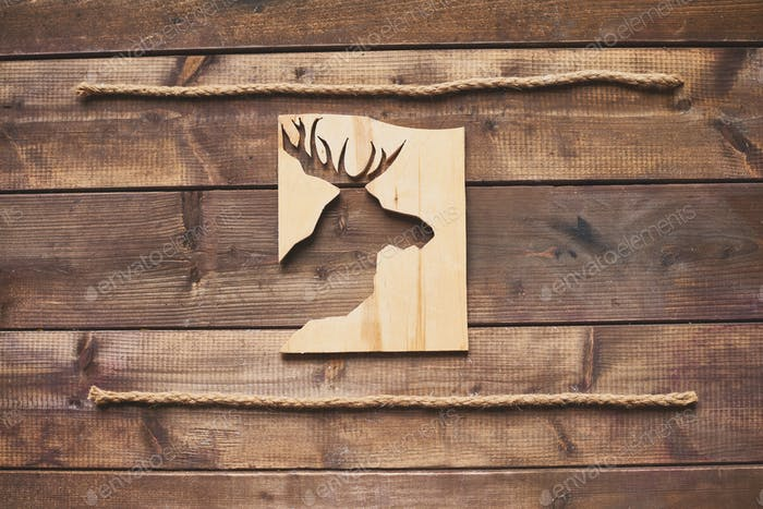 Deer cut in wooden board