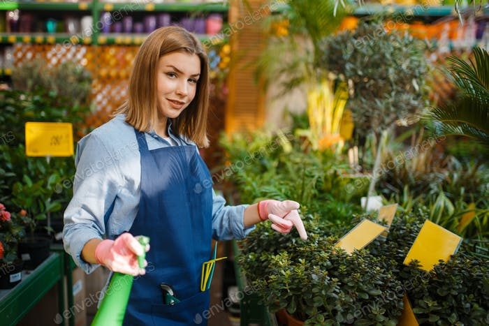 Female gardener with shovel, shop for gardening