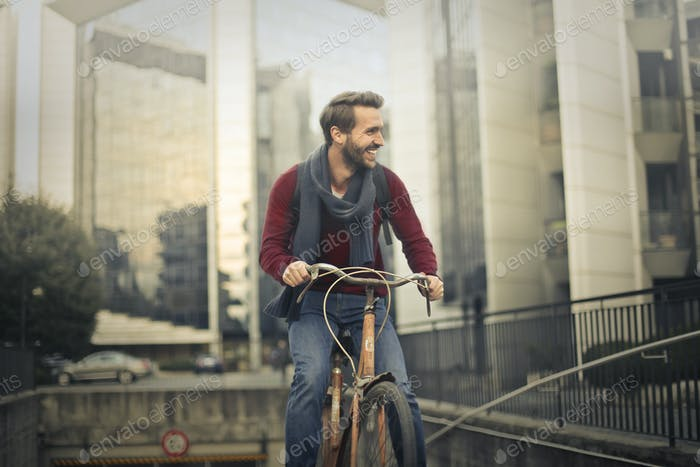 Man cycling in an urban context