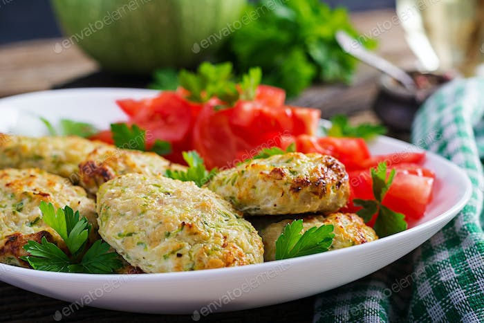 Chicken cutlet with zucchini and tomatoes salad. Healthy food.