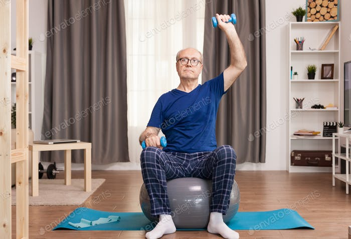 Grandfather using dumbbells