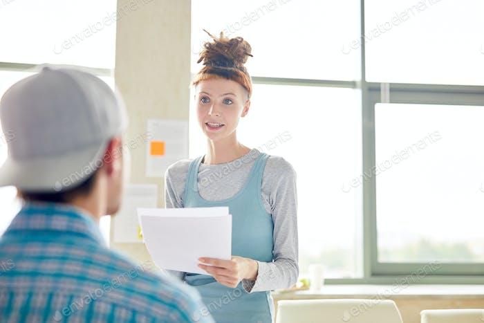 Confident student girl explaining project idea