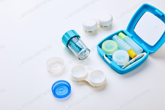 Composition with contact lenses and accessories on white background