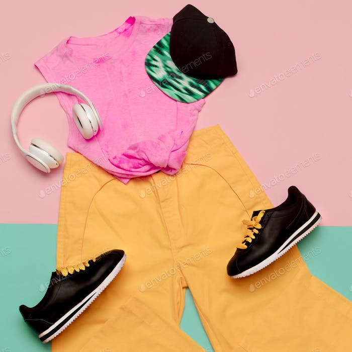 Flat lay fashion sports outfit set: shoes sneakers, trousers and