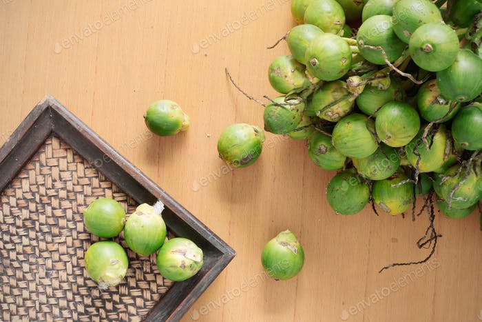 betel nut and tray on wooden