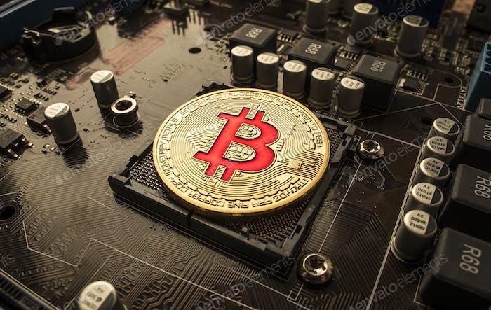 Moneda de oro BTC monedas en la placa base. Bitcoin es un worldwi