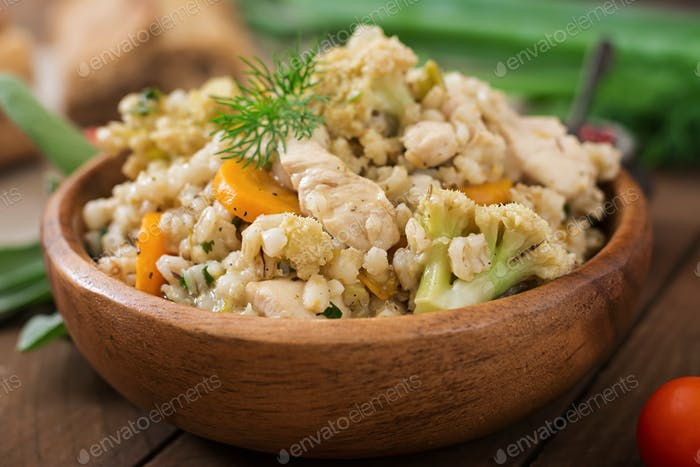 Tasty pearl barley porridge with vegetables and chicken