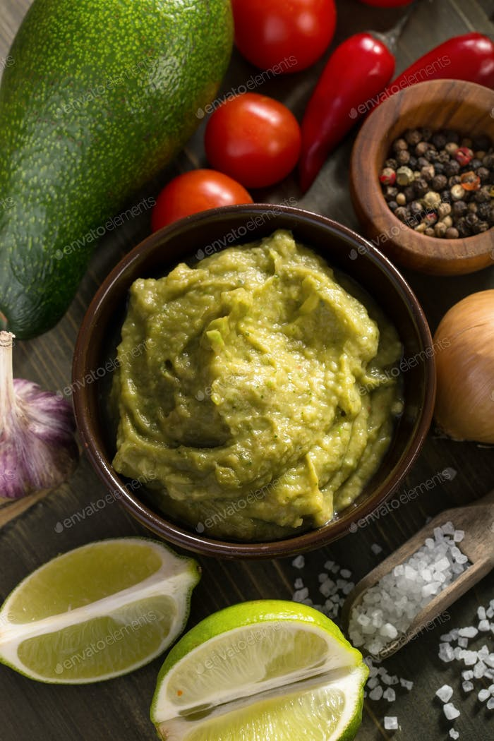 Fresh guacamole sauce and ingredients