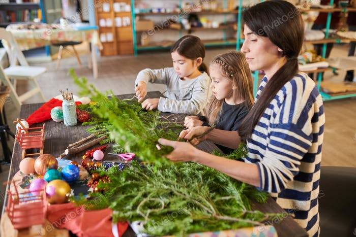 Family Making Christmas Wreaths